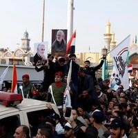Des participants à des funérailles à Bagdad.