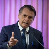 M. Bolsonaro sourit.