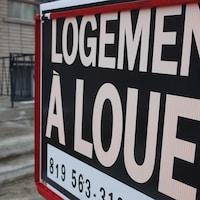 Une pancarte de logement à louer