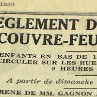 Une page de journal où il est écrit Règlement de couvre-feu.