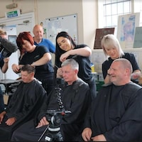 Local businesses and charities in the English town of Reading put on a pampering day for the homeless, providing up to 100 disadvantaged people with free haircuts, manicures, skin care and massages.