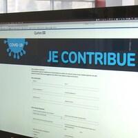 Un écran d'ordinateur sur la page d'accueil du site « Je contribue! »