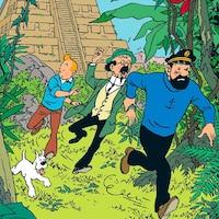 Tintin et ses acolytes courent dans la jungle.