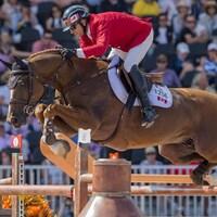 Éric Lamaze sur Chacco Kid franchit un obstacle aux Jeux équestres mondiaux