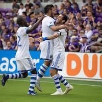 Ignacio Piatti est félicité par ses coéquipiers après avoir marqué un but à Orlando.
