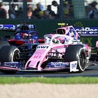 Lance Stroll (no 18) devant la Toro Rosso de Daniil Kvyat lors du Grand Prix d'Australie