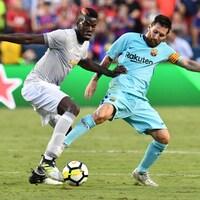Paul Pogba (gauche) et Lionel Messi (droite)