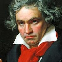 Le compositeur Ludwig van Beethoven en train d'écrire sur une partition de musique.