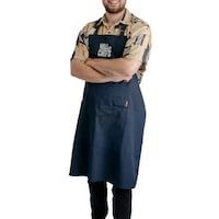 Nicolas Mongeon porte fièrement son tablier Wall of Chefs.