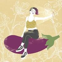 Une fille en train de prendre un égoportrait assise sur une aubergine géante.