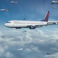 Une trentaine d'avions volent dans le ciel au dessus des nuages.