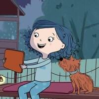 Elle joue avec sa tablette et son chien la regarde