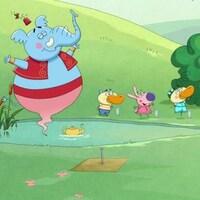 Génie et ses amis dansent autour d'une marre d'eau.
