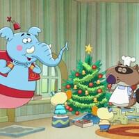 Génie et ses amis sont rassemblés autour d'un beau sapin de Noël bien décoré.