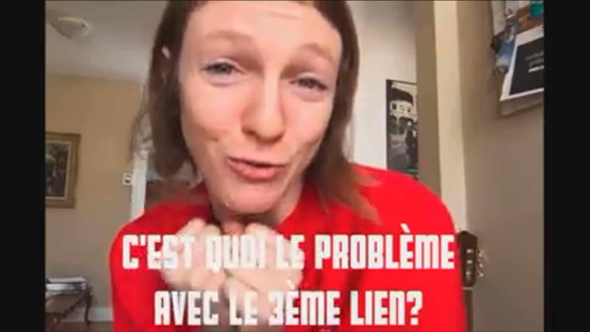 Capture d'écran tirée de la vidéo publiée par Catherine Dorion sur Facebook. La députée porte un chandail rouge. On aperçoit, au bas de l'écran, la phrase «C'est quoi le problème avec le 3e lien?».