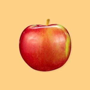 Une pomme sur un fond jaune.