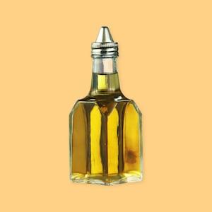 Une bouteille de vinaigre sur un fond jaune.
