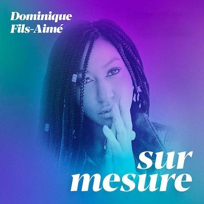 Le visage de Dominique Fils-Aimé et le logo de l'émission Sur mesure.