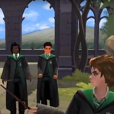 Une élève de Serpentard menaçant de sa baguette magique un élève de Gryffondor.