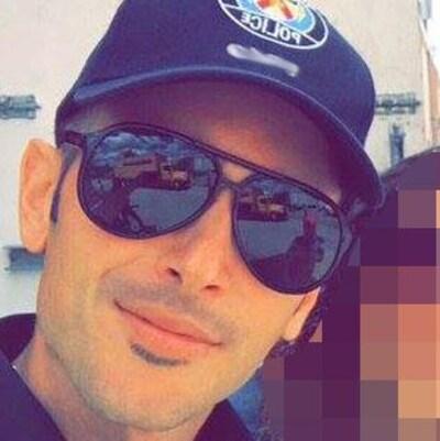Photo de l'agent Vittorio Dominelli portant des lunettes fumées.