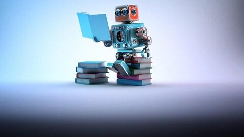 Un robot lit un livre.