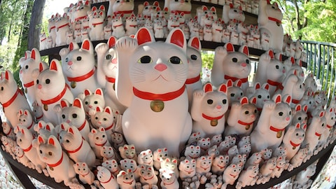 """Maneki neko"" or beckoning cat ornaments are seen on display at Gotokuji Temple in Tokyo on October 2, 2016. - The figures are believed to be a lucky charm, commonly found at temples across Japan, and are sold as popular souvenirs. (Photo by KAZUHIRO NOGI / AFP)        (Photo credit should read KAZUHIRO NOGI/AFP/Getty Images)"
