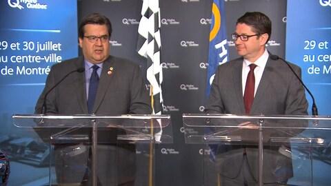Le maire Denis Coderre et le PDG d'Hydro-Québec, Éric Martel, lors d'une conférence de presse au sujet de la course de formule E à Montréal.