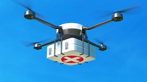 Un drone transporte une boite de pharmacie