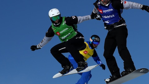 SOLITUDE, UTAH - FEBRUARY 01:   Eliot Grondin of Canada (green bib), Michele Godino of Italy (yellow bib), Baptiste Brochu of Canada (blue heat) and Lucas Eguibar (red bib) compete in the first round of Snowboard Cross Finals of the FIS Snowboard World Championships on February 01, 2019 at Solitude Mountain Resort in Solitude, Utah. (Photo by Ezra Shaw/Getty Images)