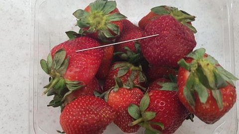 Supplied undated handout image obtained September 14, 2018 of a thin piece of metal seen among a punnet of strawberries in Gladstone. AAP/Queensland Police/Handout via REUTERS  ATTENTION EDITORS - THIS IMAGE WAS PROVIDED BY A THIRD PARTY. NO RESALES. NO ARCHIVE. AUSTRALIA OUT. NEW ZEALAND OUT.? - RC1B52016100