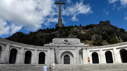 People visit the Valle de los Caidos (The Valley of the Fallen), a monument to the Francoist combatants who died during the Spanish civil war and Spain's General Francisco Franco´s final resting place on July 03, 2018 in San Lorenzo del Escorial, near Madrid. - A 150-metre-high cross on top of a basilica carved into a mountain by political prisoners...and lots of fresh flowers.  Welcome to the tomb of Francisco Franco in the Valley of the Fallen, a divisive monument from where the remains of Sp