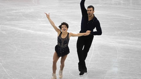 Meagan Duhamel and Eric Radford of Canada compete during the pairs short programme of the Grand Prix of Figure Skating final in Nagoya on December 7, 2017. / AFP PHOTO / Toshifumi KITAMURA
