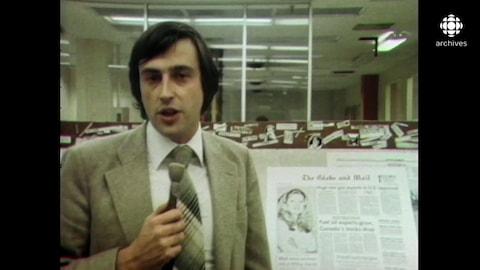Jean-Michel Leprince parle au micro, devant une édition du Globe and Mail.