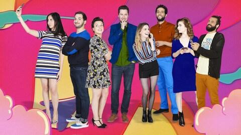 Huit jeunes prennent la pose, dont quatre plus occupés par leur téléphone intelligent que par la photo, pour l'affiche de promotion pour la version française de  Like-moi! .