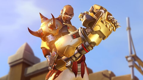 Une capture d'écran du jeu vidéo « Overwatch » montrant un personnage brandissant un énorme poing mécanique devant lui.