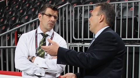 Le directeur général du Canadien Marc Bergevin et celui des Jets Kevin Cheveldayoff