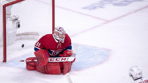 Washington Capitals centre Lars Eller (20) scores the winning goal against Montreal Canadiens goaltender Carey Price (31) during the overtime period in NHL hockey action Monday, November 19, 2018 in Montreal. THE CANADIAN PRESS/Ryan Remiorz