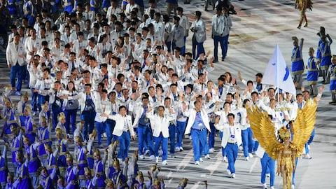 Menée par sa porte-drapeau Lim Yunghui, la délégation coréenne défile lors de la cérémonie d'ouverture des Jeux asiatiques de 2018.