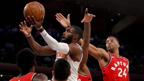 Tim Hardaway Jr. des Knicks de New York et Norman Powell des Raptors de Toronto