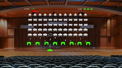 Le jeu vidéo Space Invader dans une salle de spectacle