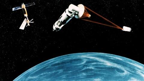 Un dessin représente un système spatial de défense par satellites.