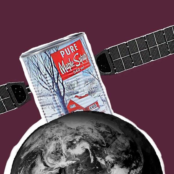 Une canne de sirop d'érable est déposée sur un globe.
