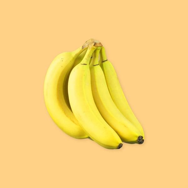 Plusieurs bananes sur un fond jaune.
