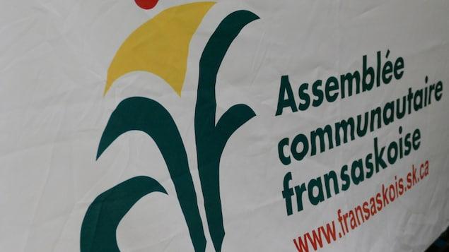 Bannière de l'Assemblée communautaire fransaskoise avec son logo et son site web.