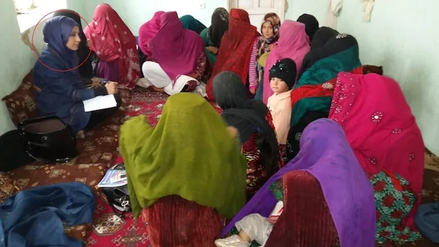 The work that Nelofar Akbari (circled left) did to teach Afghan village women about their legal rights put her on the wrong side of the Taliban.