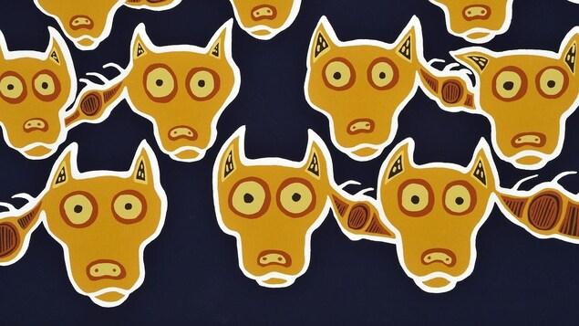 Une oeuvre d'art qui représente le visage de plusieurs loups.