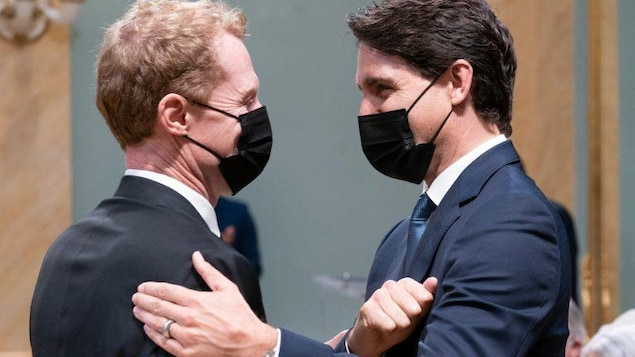 Justin Trudeau  speaks with Marc Miller at swearing in ceremony.