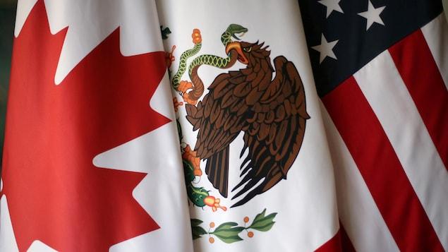 Les drapeaux des trois pays.