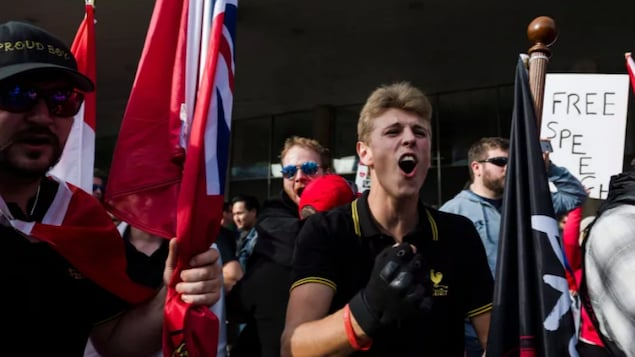 Members of the Proud Boys shout at a group of counter-protesters at Nathan Philips Square in Toronto on Saturday, October 21, 2017.