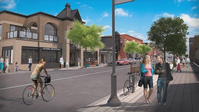 Un aperçu du futur centre-ville de Magog. Les trottoirs sont élargis, un vélo circule sur la rue et les fils électriques ont disparu.